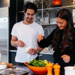 Stay-in, Save Lives: couple cooking at home