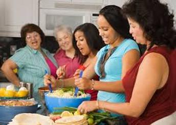 6-25 women prep food in kitchen