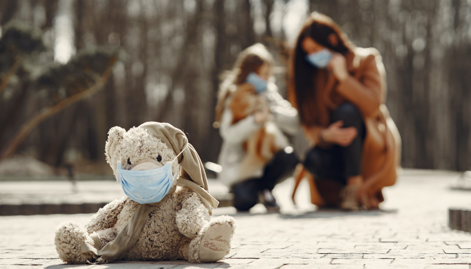 shabby-teddy-bear-in-medical-mask-sitting-on-pavement-4000604 crpd sml