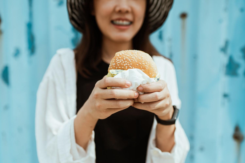 woman with delicious hamburger